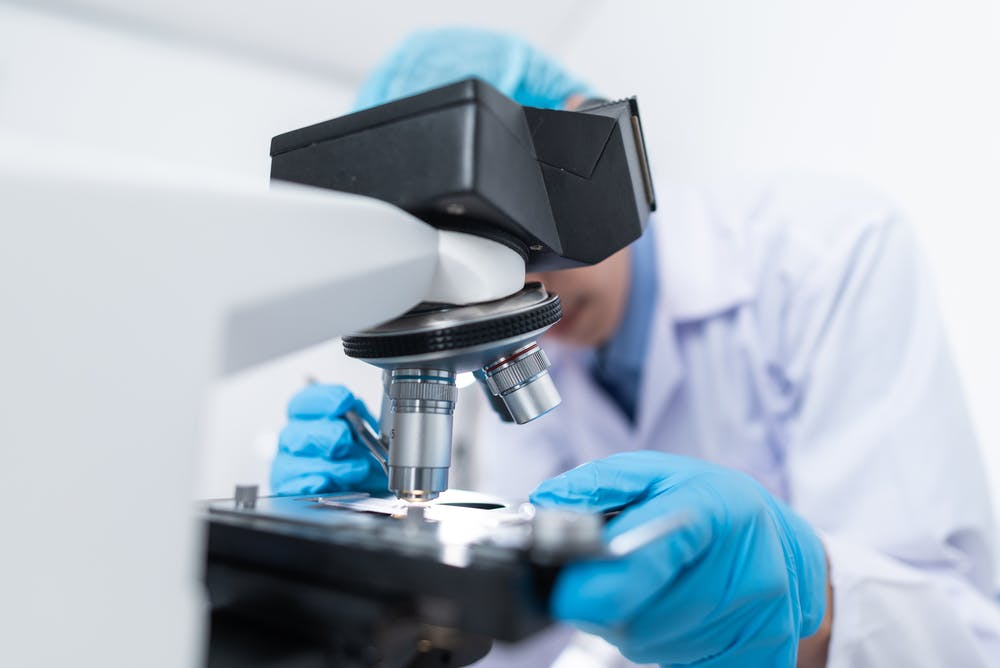 Photo of scientist doing cancer research SCOR